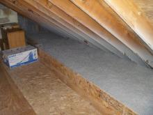 Cellulose insulation was installed in the attic, but with storage space in mind: certain parts of the attic floor were left cellulose-free.