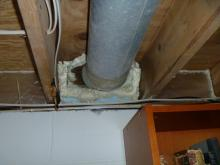 After: Orange Energy sealed the basement band joists and around duct work to stop airflow.