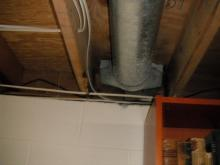 Before: the basement band joists and duct work were unsealed, allowing outdoor air to enter the home.