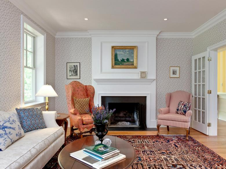 A newly insulated living room and upgraded fireplace.